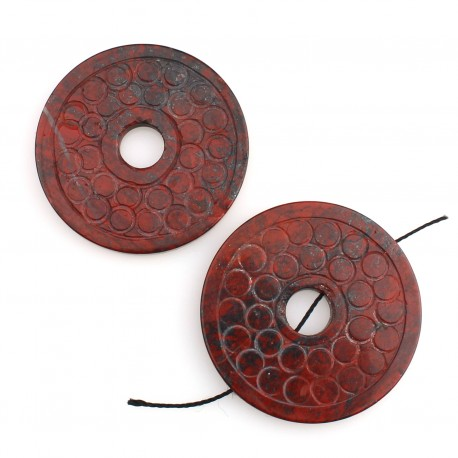 Donut with engraved circles in red jasper